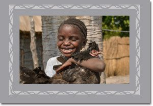 Hands of Hope - Girl Holding Chicken (1)