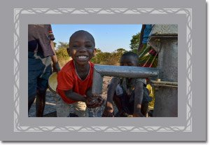 Hands of Hope - Boy Smiling by Well (2)