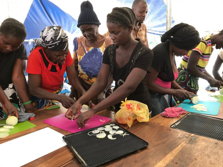 African Women Learning to Dehydrate Fruit and Vegetable