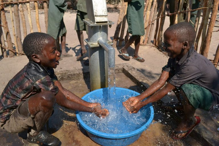 African Children Playing in Running Water