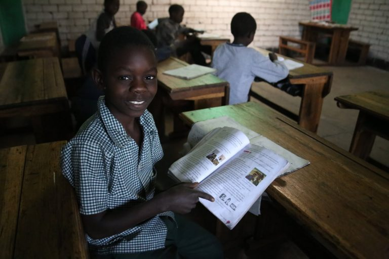 African Schoolboy at Desk
