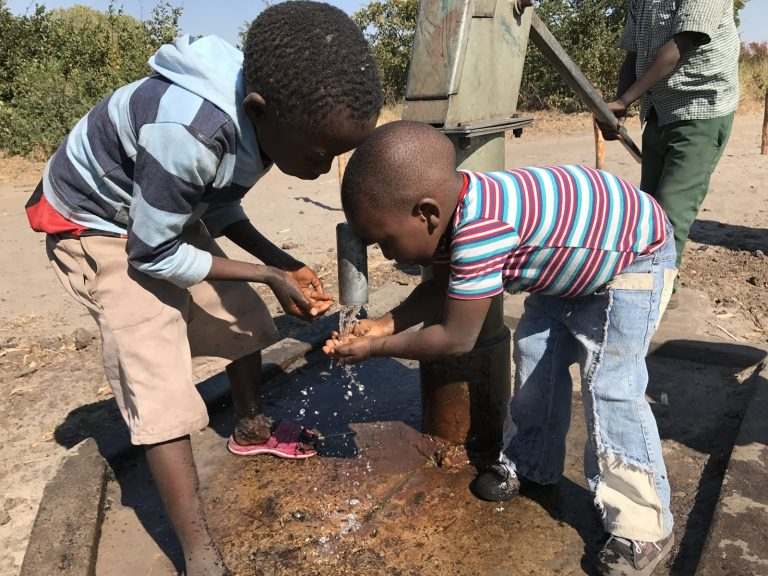 Children Playing in Well Water in Africa