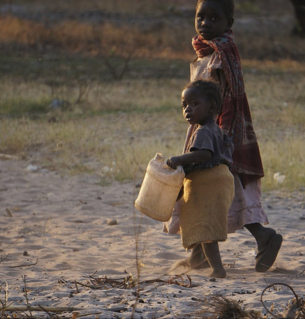 African Child Carrying Water 2